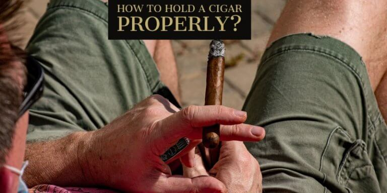how to hold a cigar